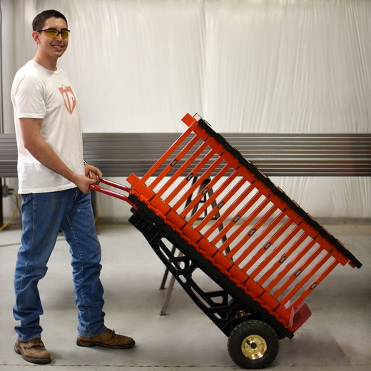 20 Wyatt Earp stands on a hand truck